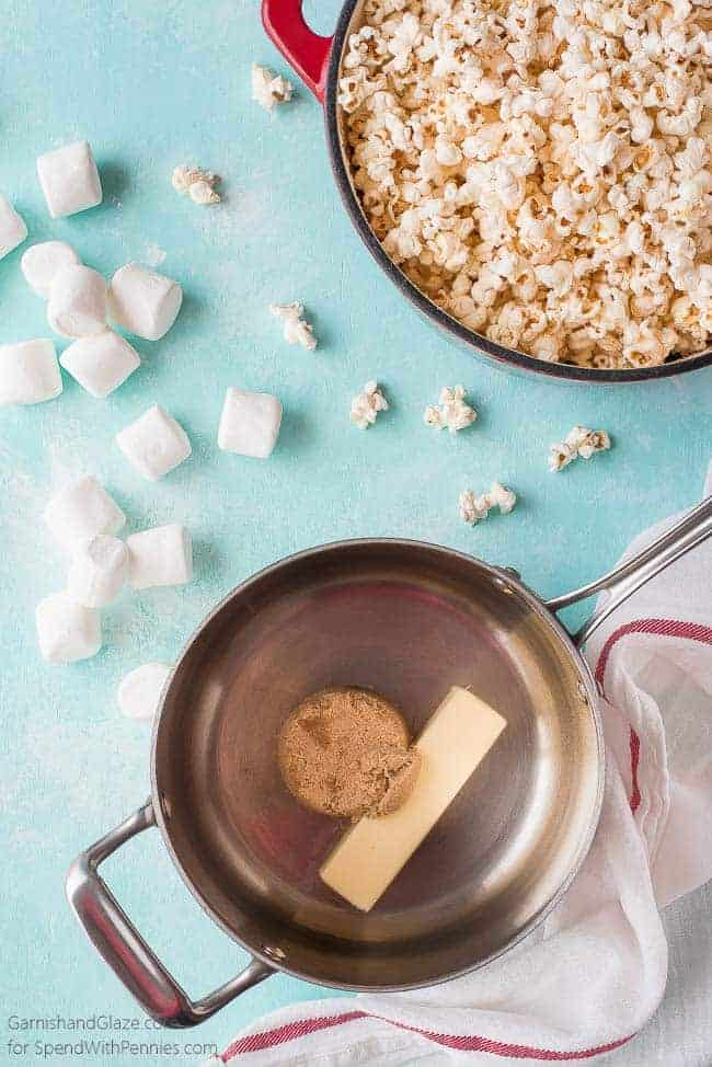 ingredients and prepping marshmallow caramel popcorn, with butter and brown sugar in a pot and popcorn in a different pot
