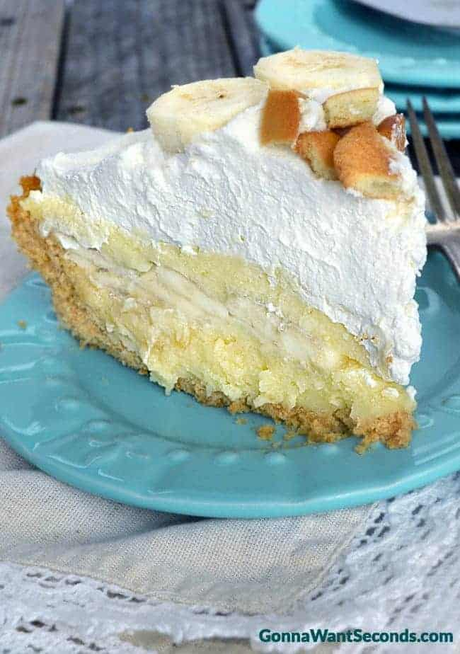 Amazing Banana Cream Pie made with a homemade rich, velvety custard, lots of fresh sliced bananas, a crunchy cookie crust, topped off with a mountain of fluffy whipped cream