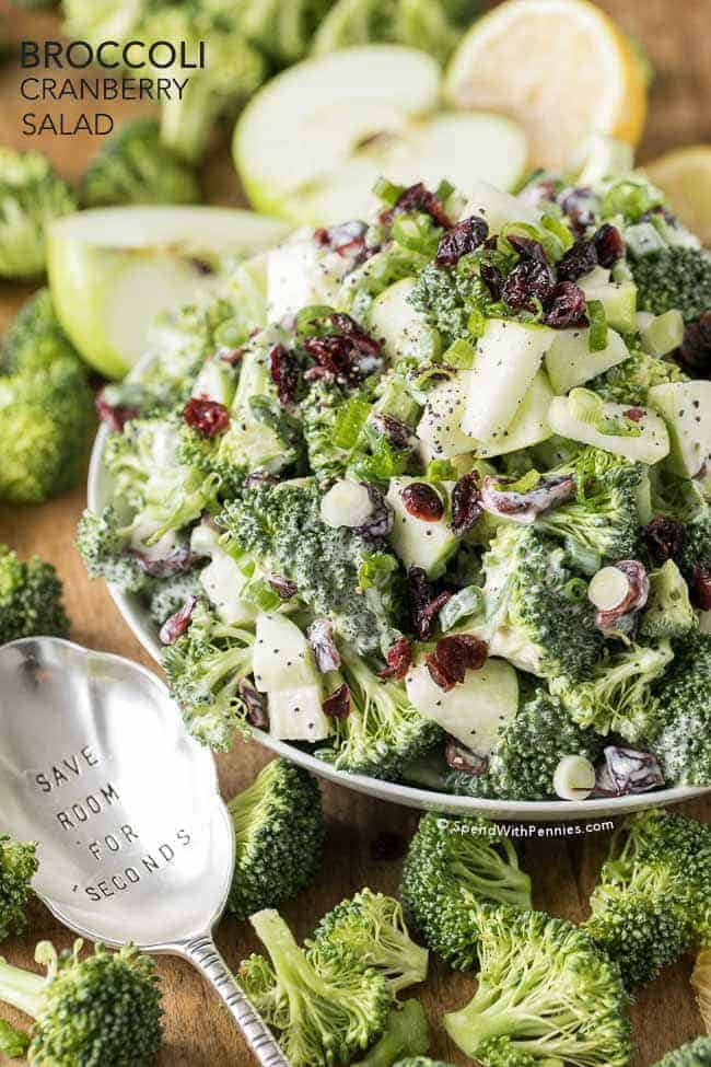 Broccoli Cranberry Salad in a white bowl with a spoon and text