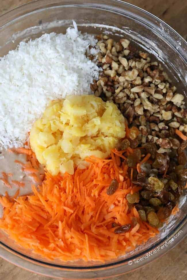 Ingredients for The BEST Carrot Cake recipe in a glass bowl