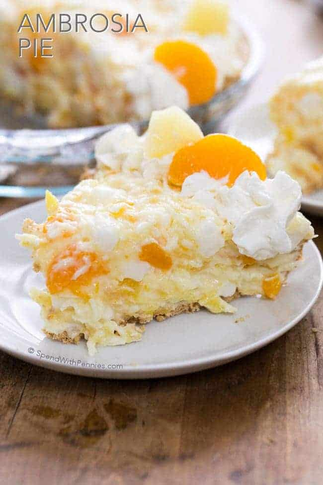 Ambrosia Pie has all of the goodness of Ambrosia Salad, tucked into a tasty graham cracker crust to be served for dessert! This no bake pie is perfect for spring parties and potlucks, and it is also a great dessert for any night of the week since it requires just a few minutes of prep!