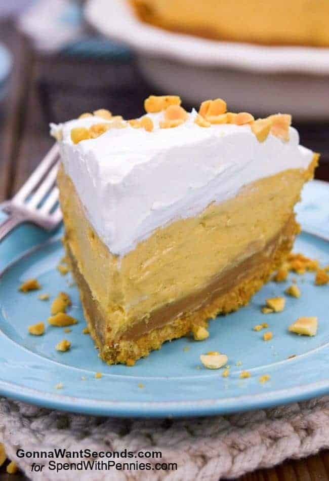 This fabulous Peanut Butter Pie is a perfect cool treat, for summer or any time of year! A delicious homemade peanut butter cookie crust pairs beautifully with the decadent peanut butter ganache layer and the creamy peanut butter middle.