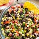 A fresh, simple dip that can be thrown together in under 15 minutes! This Cowboy Caviar makes a great side dish for any picnic, potluck, or party, and is a great way to use up your summer produce!