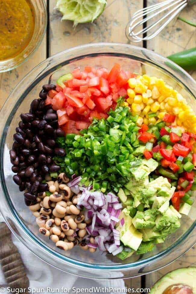 Ingredients for cowboy caviar in a glass bowl