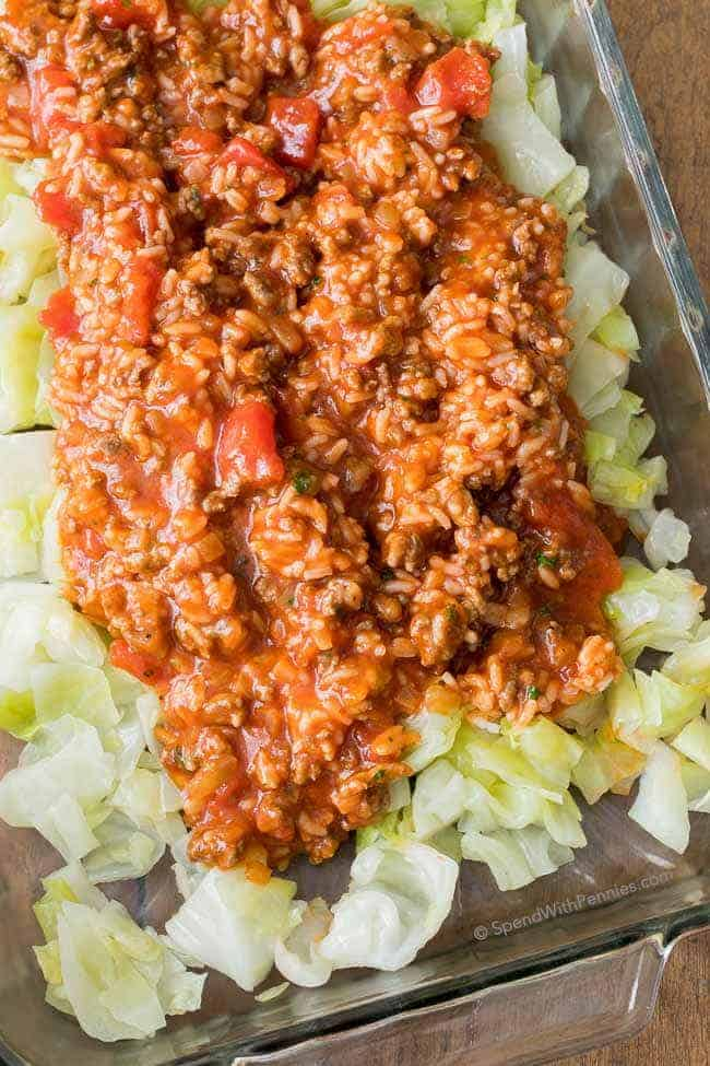 Simply layer tender cabbage and a zesty meat sauce to create a lazy cabbage casserole! This delicious unstuffed cabbage casserole is a family favorite! Easy to prepare and an inexpensive way to feed a crowd!