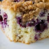 closeup of blueberry buckle with a bite out of it