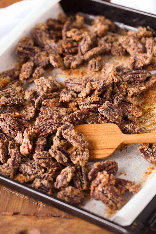 Candied Pecans on a parchment lined baking sheet