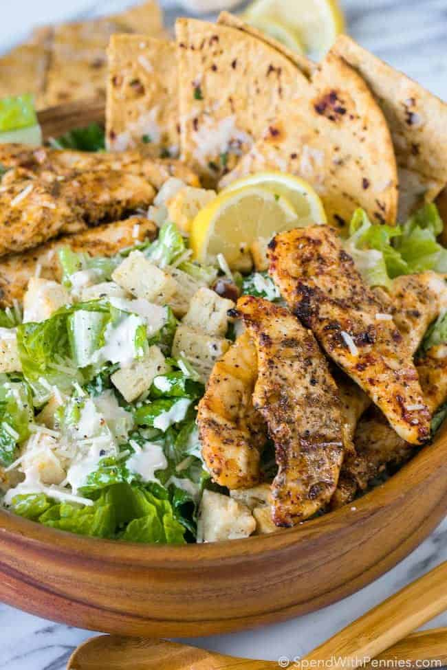 Grilled Chicken Caesar Salad with Garlic Parmesan Flatbread is the perfect summer meal! Juicy chicken, crisp fresh lettuce with a creamy garlic parmesan dressing all topped off with a grilled garlic parmesan flatbread.