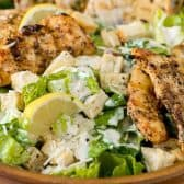closeup of Grilled Chicken Caesar Salad with tortillas