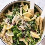 overhead of Lemon Broccolini Parmesan Pasta Salad in a pot with serving utensils