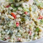 Pickled Tuna Macaroni Salad in a serving bowl topped with pickles