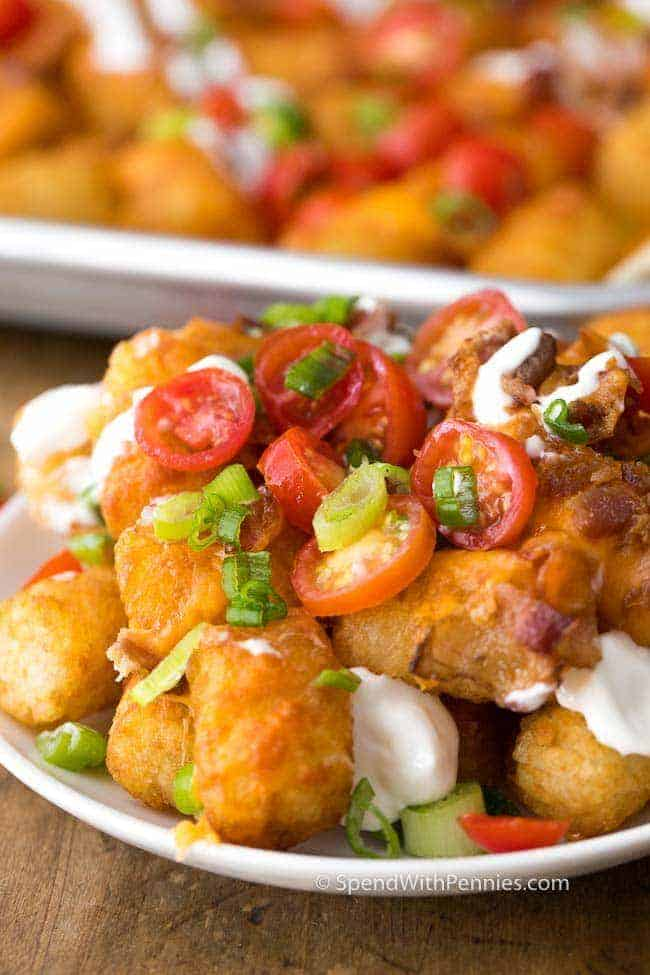 Tater Tot Nachos have crispy Tater Tots smothered in melted cheddar cheese and bacon. This snack takes just minutes to prep and is loved by absolutely everyone!