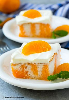 This orange creamsicle poke cake is a fluffy white cake infused with orange flavor and topped with a quick and easy vanilla frosting. It's a easy dessert that's a total crowd pleaser and perfect for any summer potluck!