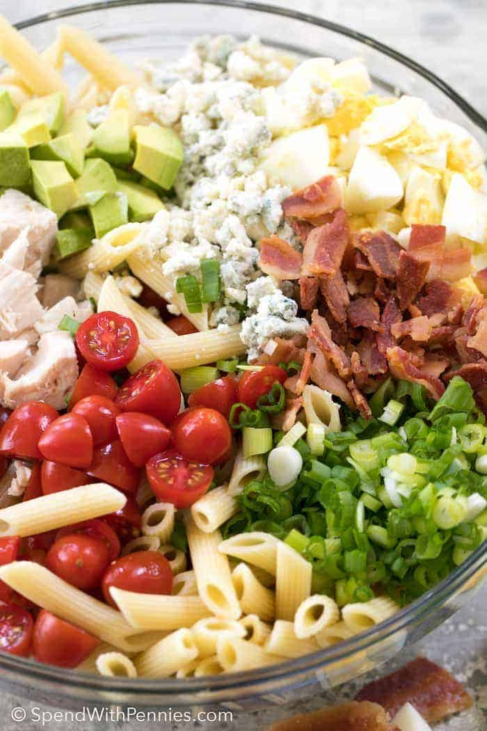 Loaded with all of my favorite summer ingredients, Cobb Pasta Salad is an easy make ahead meal! Loaded with juicy tomatoes, crisp bacon, avocados and cheese, this pasta salad can save the day at dinner time or be the star dish at any picnic or potluck spread!