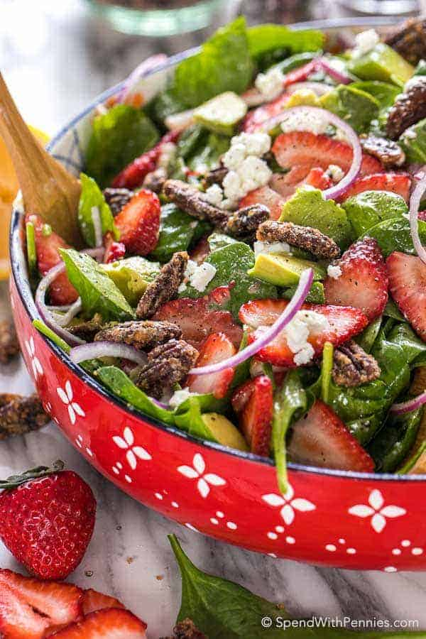 Strawberry Spinach Salad in a red bowl