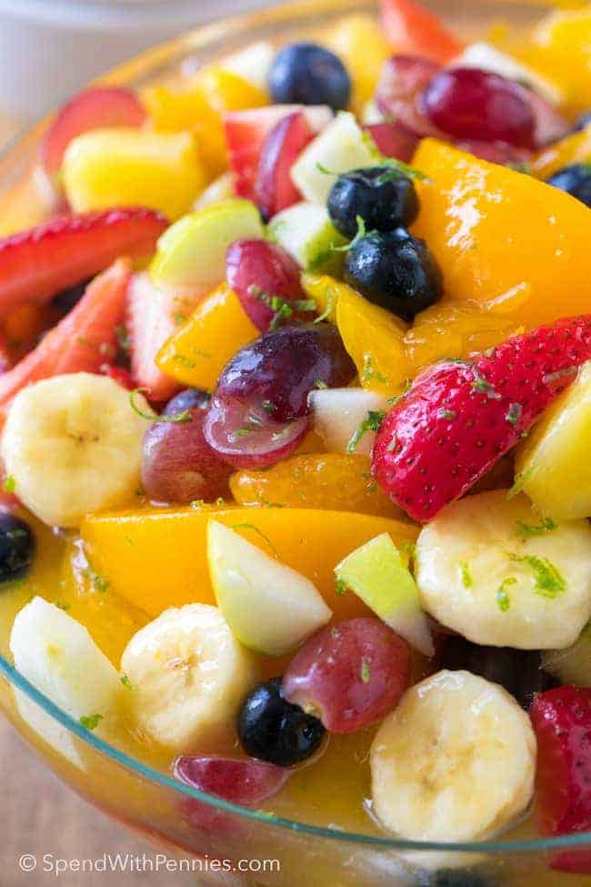 Vanilla Pudding Fruit Salad is a simple and sweet twist on a traditional fruit salad recipe. This easy dessert has a beautiful rainbow of fruit in an easy vanilla kissed sauce making it the perfect dessert or ice cream topping!