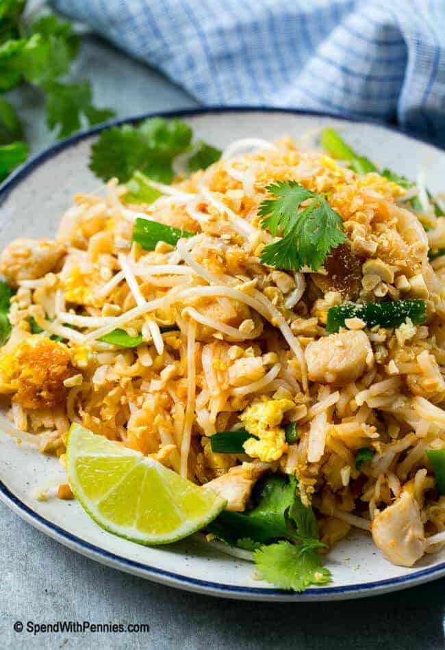 Chicken Pad Thai in a bowl with lime and peanuts