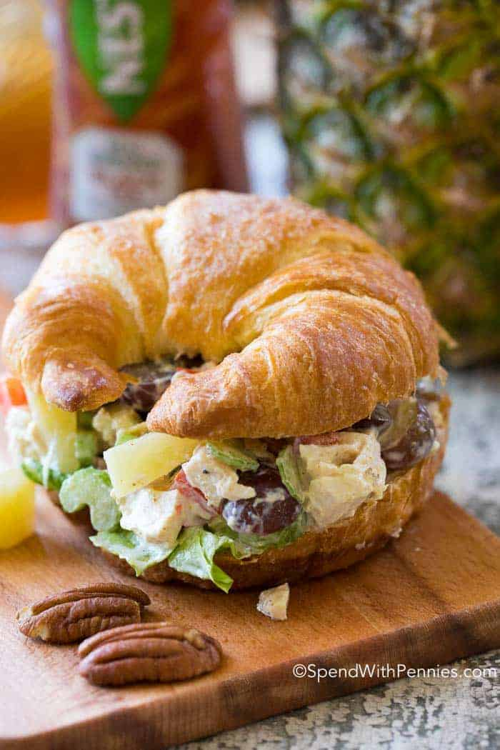 Prepared chicken salad with grapes on a croissant.