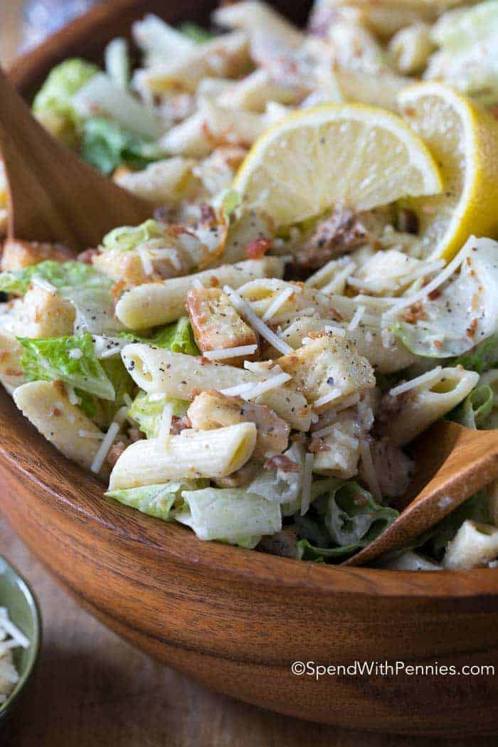 Chicken Caesar Pasta Salad is favorite summer pasta salad recipe. Caesar Salad ingredients combined with pasta in a delicious homemade dressing. Loaded with lemon, garlic and parmesan, this meal is both flavorful and filling.