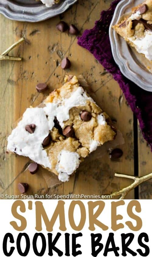 These S'mores Cookie Bars are made with graham cracker crumb based cookie layers sandwiched around melty milk chocolate and gooey marshmallow.  A fun, baked, twist on traditional S'mores -- great for enjoying indoors!