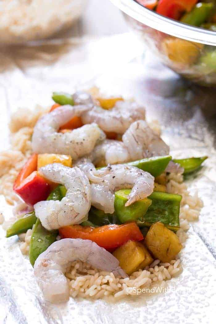 Easy Teriyaki Shrimp Foil Packets are the perfect summer meal with little clean up. Peppers, snap peas, succulent shrimp & juicy pineapple grilled in a sweet teriyaki sauce.