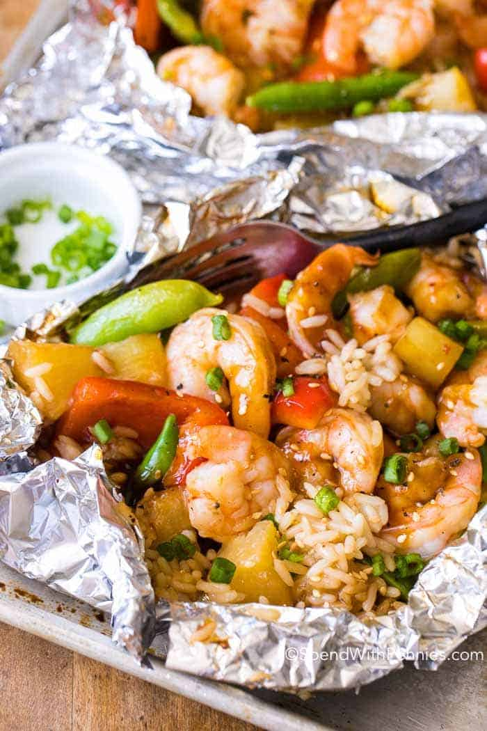 Teriyaki Shrimp foil packets are quick and easy with little clean up. Tender crisp vegetables, succulent shrimp & juicy pineapple grilled in a sweet teriyaki sauce.