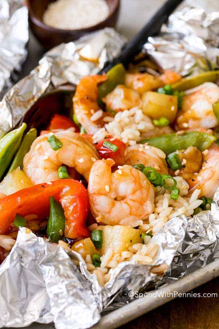 Bell peppers, snap peas, succulent shrimp & juicy pineapple grilled in a sweet teriyaki sauce make these easy Shrimp Foil Packets a family favorite. The perfect quick and easy dinner on the grill!