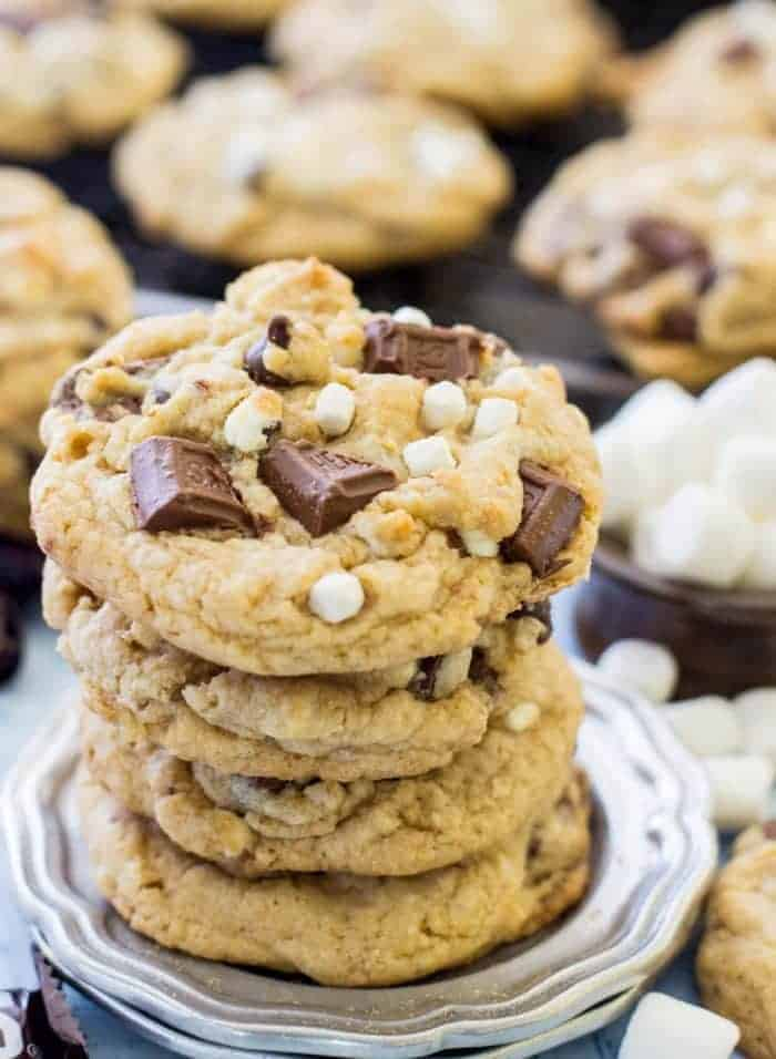 Slightly crisped, perfectly marshmallow-y, gooey and exceedingly chocolatey s'mores cookies made with a graham cracker base. These S'mores Cookies are the perfect way to get your s'mores fix without a campfire.