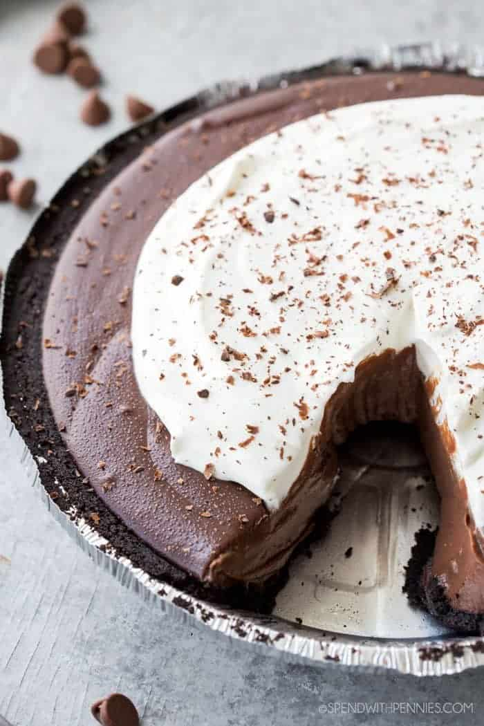 Chocolate Silk Pie: A chocolate pie that is silky smooth, creamy, and delicious, in an OREO crust, and topped with whipped cream and shaved chocolate! This pie is a crowd pleaser and very easy to make.