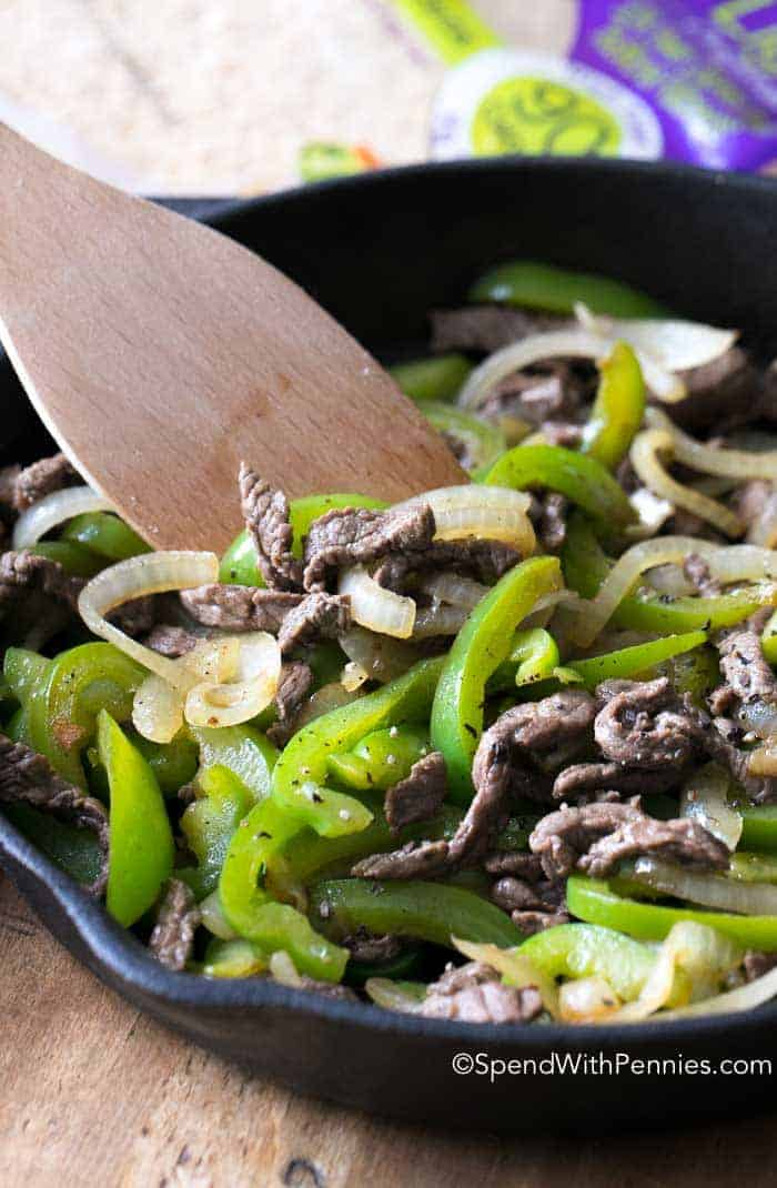 This easy Philly Cheese Steak is delicious. Tender ribeye, sweet caramelized onions and crisp green peppers all smothered in provolone. This makes the best sandwich ever!