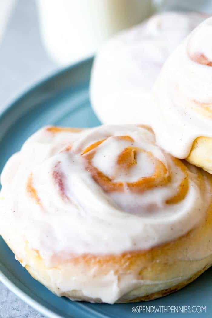 Pumpkin Cinnamon Rolls with cream cheese icing on plate