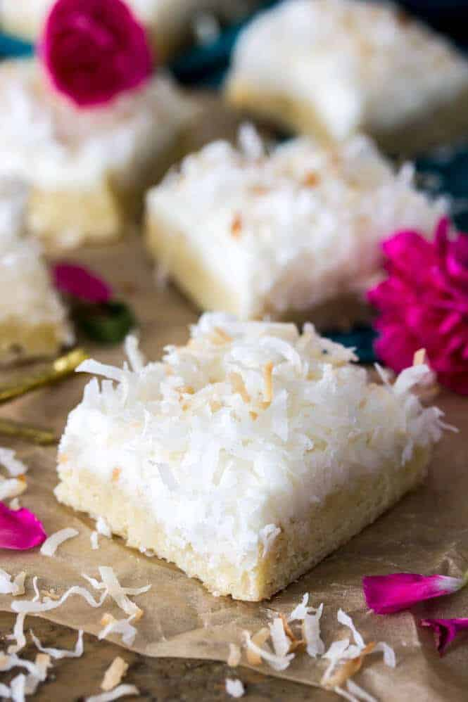 These coconut cream bars are made with a soft, buttery cookie bar base topped with a light coconut cream frosting, all topped off with toasted coconut. Simple and delicious, these coconut-infused dessert bars make a perfect springtime treat!