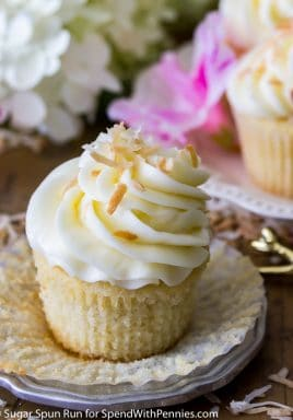 Coconut cupcakes are soft, fluffy cupcakes (with both a from-scratch recipe and the option to use a box-mix!), topped off with a cream cheese based coconut buttercream frosting and then sprinkled with lightly toasted coconut!
