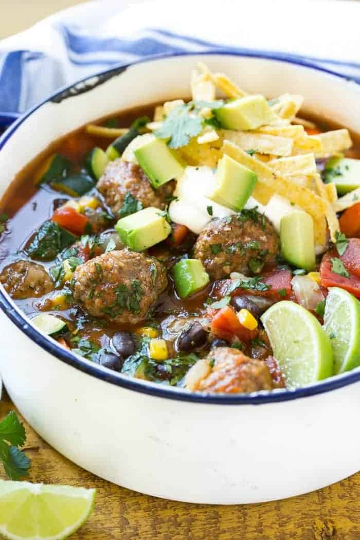 This recipe for Mexican Meatball Soup is loaded with seasoned beef meatballs, black beans and plenty of vegetables in a flavorful and spicy broth. Add your favorite toppings and you've got a complete meal in a bowl!