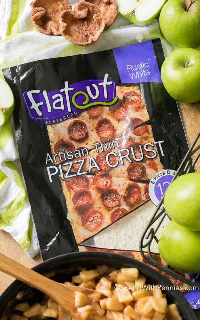Overhead shot of package of Flatout Pizza Crust surrounded by green apples