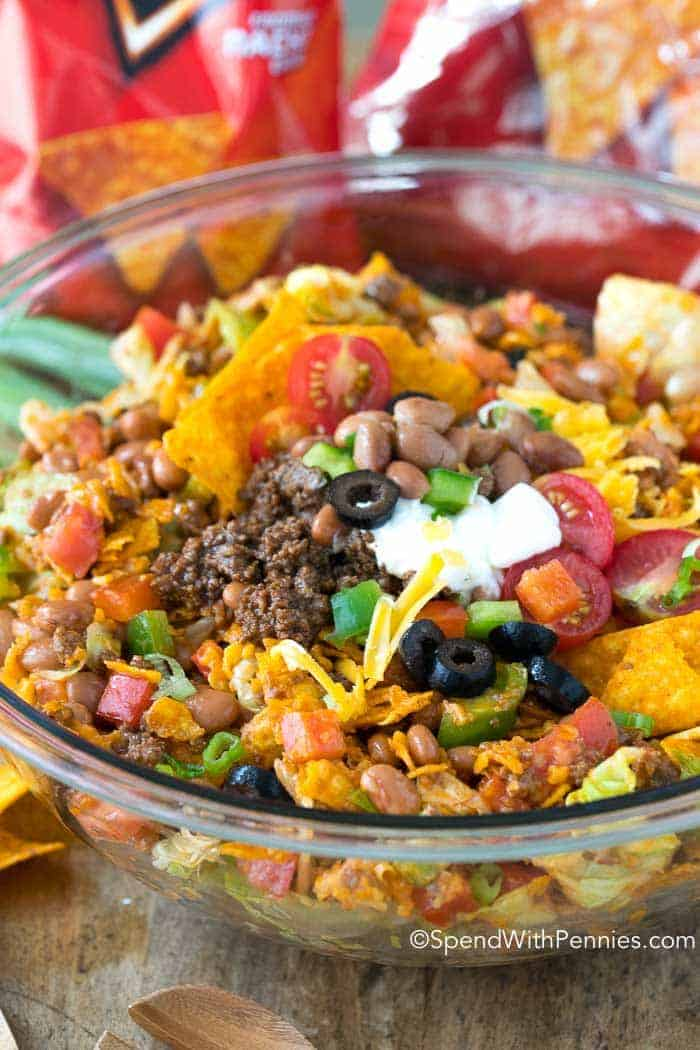 Everyone at our potluck went CRAZY for this Dorito Taco Salad! And it's SO easy to make!