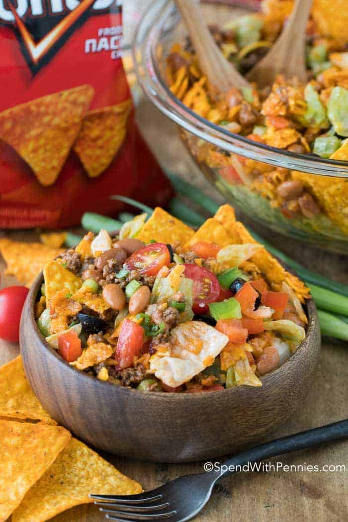 This is my favorite taco salad! Dorito Taco Salad is a crowd favorite with loads of seasoned ground beef, veggies, beans and Doritos in a zesty dressing!
