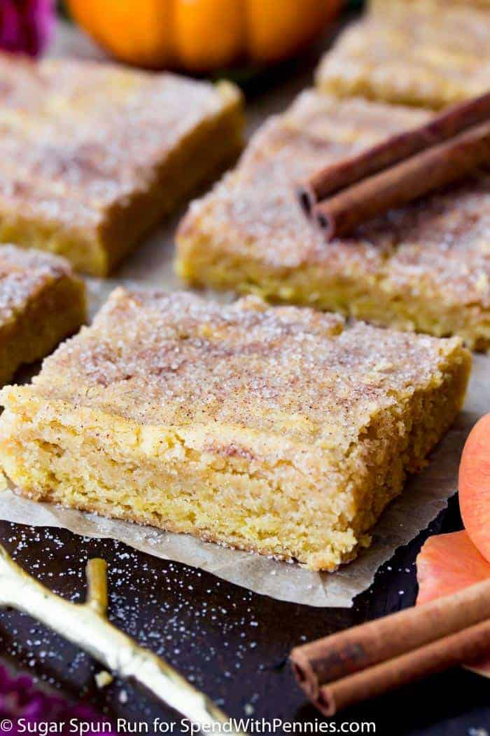 Sweet, chewy, cinnamon-sugared Pumpkin Blondies are great festive fall treats!  Flavored with real pumpkin and seasonal pumpkin spice, these treats are utterly addictive!