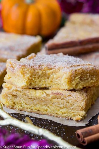 Two stacked Pumpkin Blondies, one with a bite taken out of it.