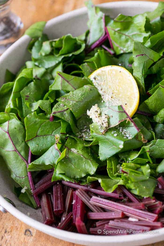 Fresh Beet stems and leaves are tossed with garlic and lemon and cooked until tender. This is my new favorite way to enjoy beet greens!