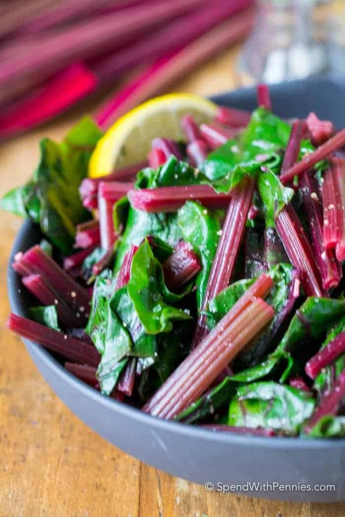 Beet Greens are tossed with garlic and lemon and cooked until tender.  Once tender these greens are tossed with a touch of butter and seasoned to perfection for a delicious side dish.