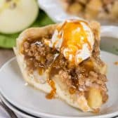 Apple Crumb Cheesecake Pie with caramel drizzle