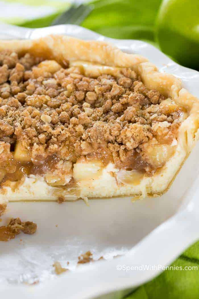 Apple Crumb Cheesecake Pie with slice cut out