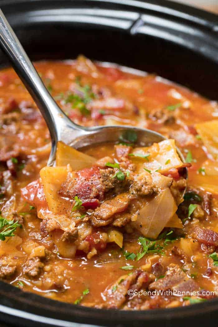 Slow Cooker Cabbage Roll Soup! Cabbage, onion, beef and bacon all tenderly prepared in a rich beef and tomato broth, slowly simmered in your crock pot all day. This creates a nutritious and tasty soup that will warm your belly from the inside out!