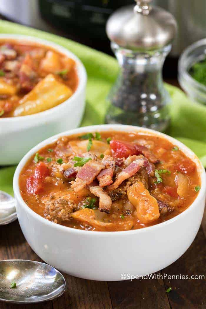 Crock Pot Cabbage Roll Soup in white bowl with pepper in backgorund