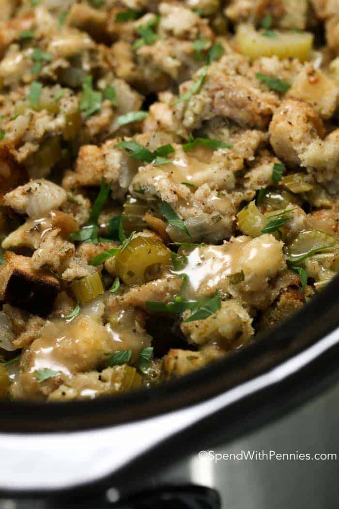 Stuffing made in the slow cooker from scratch is the perfect addition to any turkey dinner! This delicious recipe is one of our all time favorites!