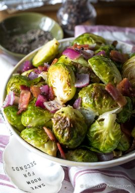 Garlic Roasted Brussels Sprouts in a serving bowl with bacon