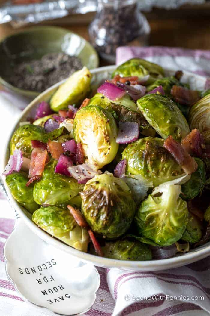 Roasted Brussels Sprouts with Bacon in a bowl with a serving spoon.
