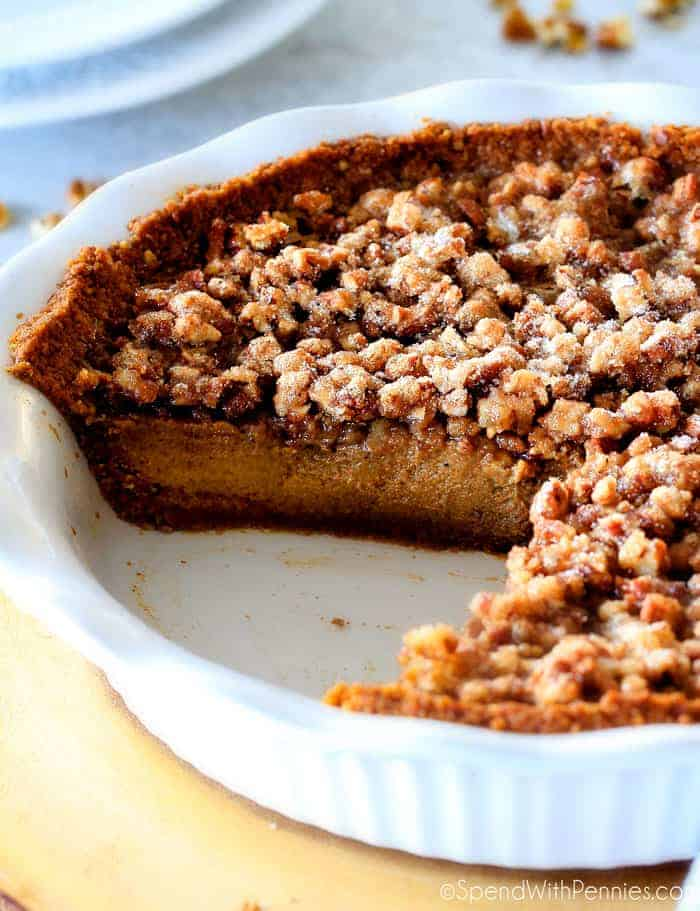 This Praline Pumpkin Pie is a Thanksgiving must! Creamy pumpkin pie topped with crunchy, chewy brown sugar pecans for the perfect flavor and texture combination in every bite!