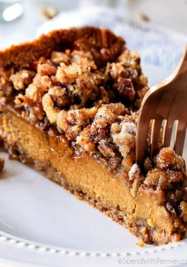 This Pumpkin Praline Pie is a Thanksgiving must! Creamy pumpkin pie topped with crunchy, chewy brown sugar pecans for the perfect flavor and texture combination in every bite!